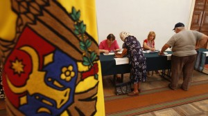 Moldovan citizens wait to cast their ballots at a polling station in Chisinau