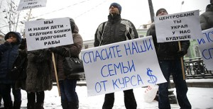 Protesters hold placards during a picket in central Moscow