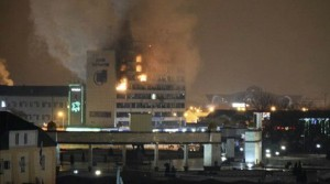 A local media building known as the Press House burns as militants attack in Grozny