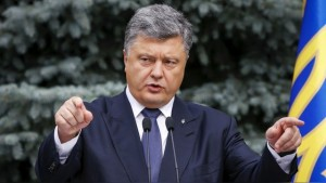 Ukraine's President Poroshenko gestures as he proposes his project of changes in the constitution on decentralizing power in Kiev