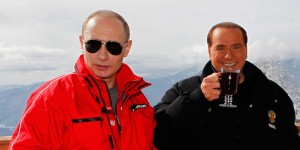 Russia's outgoing President Dmitry Medvedev (R) and newly elected president Vladimir Putin (L) meet with former Italy's Prime minister Silvio Berlusconi at the Rosa Khutor apline ski resort in Krasnaya Polyana, some 50kms from Sochi on March 8, 2012. Italy's ex-prime minister Silvio Berlusconi flew into Russia for a lavish dinner with Vladimir Putin after his old ally's victory in presidential elections, state television said . AFP PHOTO/RIA-NOVOSTI/POOL/DMITRY ASTAKHOV (Photo credit should read DMITRY ASTAKHOV/AFP/Getty Images)