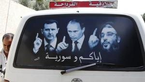 poster Assad Putin Hezbollah leader Nasrallah